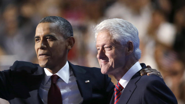Reunited Obama, Bill Clinton tout health care law
