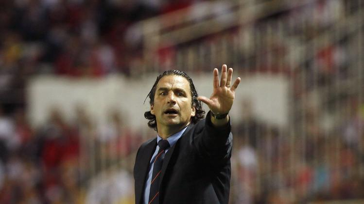 Valencia's coach Pizzi waits for the start of their Europa League semi-final first leg soccer match against Sevilla, in Seville