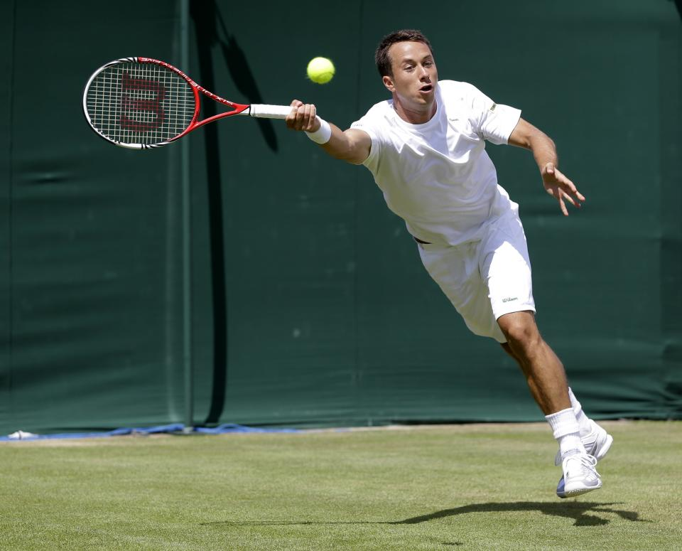 Philipp Kohlschreiber of Germany returns a shot to Lukas Rosol of the Czech Republic during a third round men's singles match at the All England Lawn Tennis Championships at Wimbledon, England, Saturday, June 30, 2012. (AP Photo/Kirsty Wigglesworth)