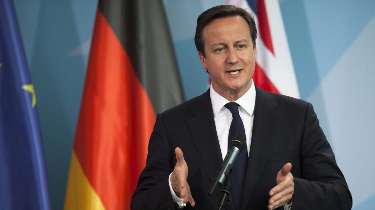 Prime Minister David Cameron briefs the media prior to a bilateral meeting with German Chancellor Angela Merkel at the chancellery  in Berlin, Germany, Thursday, June 7, 2012. (AP Photo/Markus Schreiber)