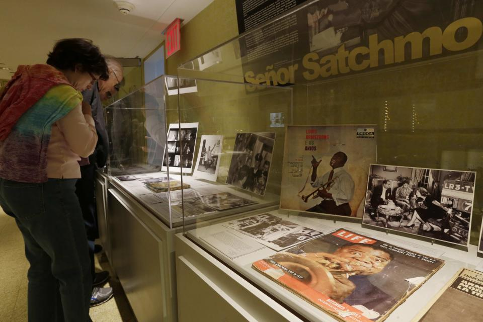 Patrons view items on display at the Louis Armstrong House Museum Wednesday, Oct. 9, 2013, in the Queens borough of New York. (AP Photo/Frank Franklin II)