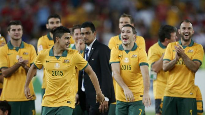 Australia's Massimo Luongo reacts as he proceeds to collect the Most Valuable Player award during the trophy presentation ceremony of the Asian Cup at the Stadium Australia in Sydney