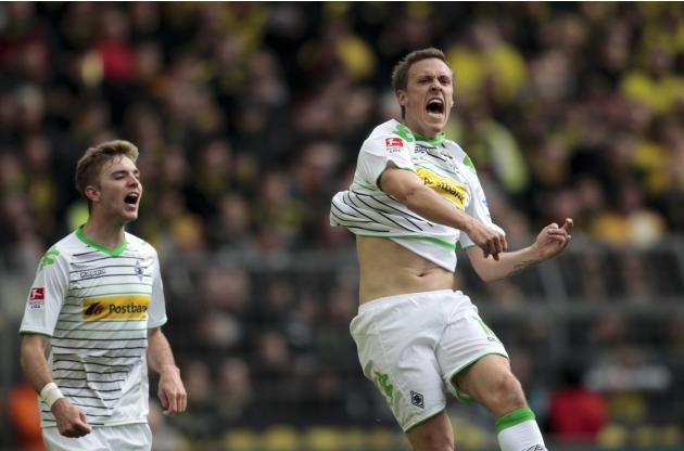 Borussia Moenchengladbach's Kramer and Kruse celebrate a goal against Borussia Dortmund during the German first division Bundesliga soccer match in Dortmund