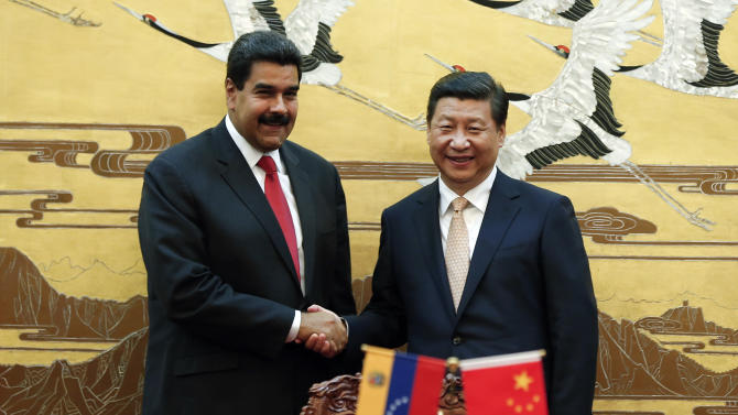 Venezuela's president in China, signs agreements