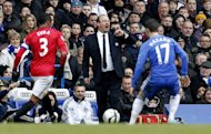 Chelsea's interim Spanish manager Rafael Benitez (C) reacts during the FA Cup quarter final replay football match between Chelsea and Manchester United at Stamford Bridge stadium in London, England on April 1, 2013. Chelsea won 1-0