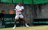Aqeel Khan of Pakistan plays Artem Sitak of New Zealand in their Davis Cup match in Yangon on April 5, 2013. Pakistan has vowed to fight on after the tennis world governing body rejected their appeal over their forfeited Davis Cup tie against New Zealand.