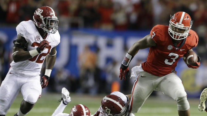 Georgia running back Todd Gurley (3) breaks the tackle of Alabama linebacker Trey DePriest (33) during the first half of the Southeastern Conference championship NCAA college footballgame, Saturday, Dec. 1, 2012, in Atlanta. (AP Photo/David Goldman)