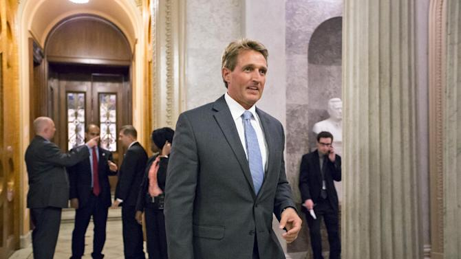 "FILE - In this Sept. 30, 2013, file photo Sen. Jeff Flake, R-Ariz., leaves the Senate Chamber. Budget bargainers last year decided to go small rather than big and ambitious, giving up on an elusive ""grand bargain"" that simply wasn't in the cards. They settled on a small-scale budget pact, including a seemingly easily justifiable spending cut, trimming the generous pension benefits of working-age military retirees. What they also got was a lesson in how hard it is to actually cut spending. Congress promptly caved in to pressure from the powerful veterans lobby and restored the cut. ""It's tough to overstate how devastating that was,"" said Flake, one of just three senators who voted to keep the pension reduction in place. ""It's back to the drawing board, because that was a big blow."" (AP Photo/J. Scott Applewhite, File)"