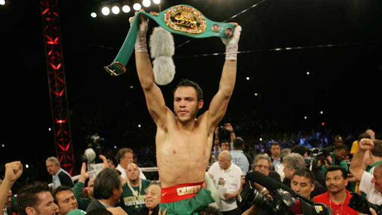 Julio Cesar Chavez Jr. celebrates his victory over Andy Lee in their WBC middleweight title bout Saturday, June 16, 2012, in El Paso, Texas. (AP Photo/El Paso Times, Victor Calzada) EL PASO OUT  JUAREZ, MEXICO, OUT