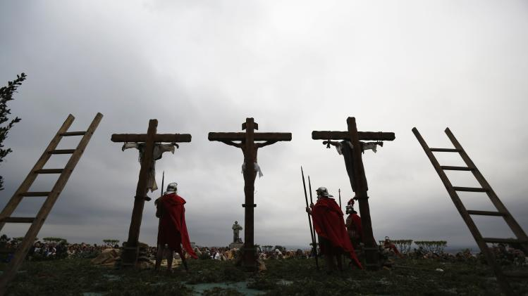 "Worshippers re-enact ""Stations of the Cross"" during procession on Good Friday in Ourem"