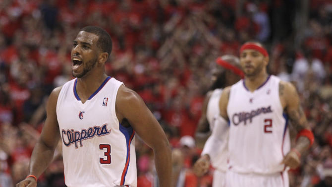 Los Angeles Clippers' Chris Paul celebrates a basket during overtime in a NBA first-round playoff basketball game against the Memphis Grizzlies in Los Angeles, Monday, May 7, 2012. The Clippers won 101-97 in overtime.(AP Photo/Chris Carlson)