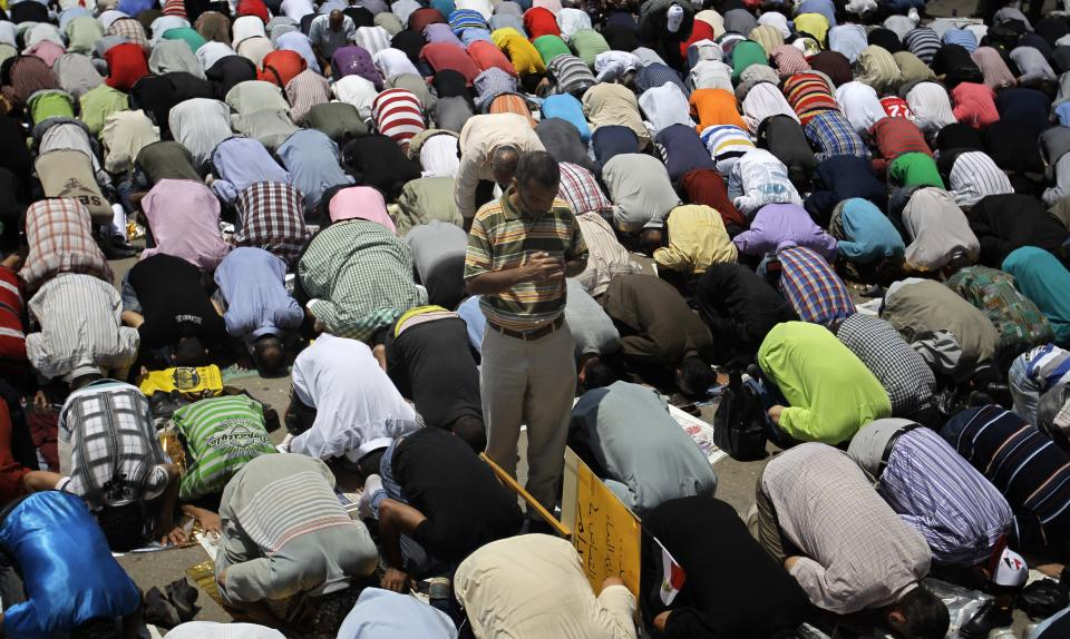 Egyptians attend Friday prayers in Tahrir Square in Cairo,  Friday, July 1, 2011.  (AP Photo/Sergey Ponomarev)