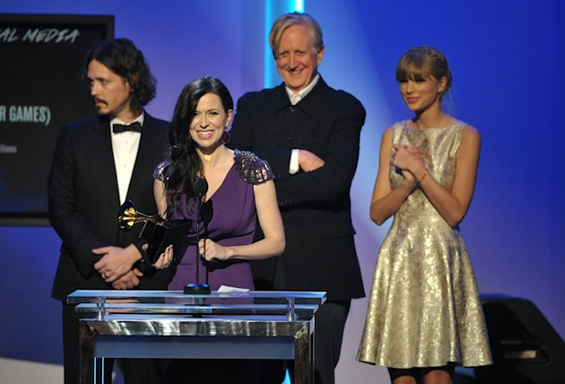 "From left, John Paul White, Joy Williams, T Bone Burnett and Taylor Swift accept the award for song written for visual media for ""Safe and Sound"" (From The Hunger Games) at the 55th annual Grammy Awards on Sunday, Feb. 10, 2013, in Los Angeles. (Photo by John Shearer/Invision/AP)"