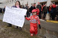 "Michael Schumacher fans hold a banner reading ""Happy Birthday Schumi"" to mark his 45th birthday outside the Grenoble University Hospital Centre on January 3, 2014"