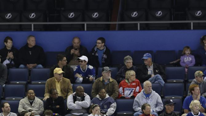 Tampa Bay Lighting fans watch the team during NHL hockey training camp, Friday, Jan. 18, 2013, in Tampa, Fla. The Lightning open their 48-game season against the Washington Capitals on Saturday night. (AP Photo/Chris O'Meara)
