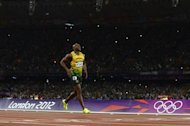 Jamaica's Asafa Powell reacts after the men's 100m final at the athletics event during the London 2012 Olympic Games on August 5, 2012 in London.   AFP PHOTO / ADRIAN DENNIS