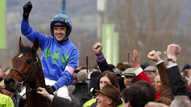 Ruby Walsh on Hurricane Fly celebrates after winning the Champion Hurdle Challenge Trophy during the Cheltenham Festival (Reuters)