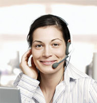 Dialing Your Detractors: 4 Steps to an Effective Closed Loop Survey image Friendly woman on phone 3x3