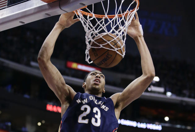 New Orleans Pelicans' Anthony Davis dunks during the first half of an NBA basketball game against the Los Angeles Clippers on Wednesday, Dec. 18, 2013, in Los Angeles