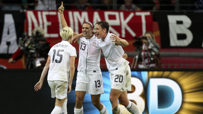 United States' Alex Morgan, center, celebrate with United States' Abby Wambach and United States' Megan Rapinoe, left, scoring the opening goal during the final match between Japan and the United States at the Women's Soccer World Cup in Frankfurt, Germany, Sunday, July 17, 2011. (AP Photo/Michael Probst)