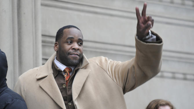 FILE - In this Jan. 29,2013 file photo former Mayor Kwame Kilpatrick waits in line to enter federal court in Detroit.  Testimony in Kilpatrick's corruption trial ended Thursday, Feb. 6, 2013 after nearly 70 days of testimony. Kilpatrick offered no new witnesses Wednesday and closing arguments have been set for Monday in Detroit federal court. (AP Photo/The  Detroit News, David Coates) DETROIT FREE PRESS OUT, HUFFINGTON POST OUT, NO MAGS, NO SALES, NO ARCHIVE, MANDATORY CREDIT