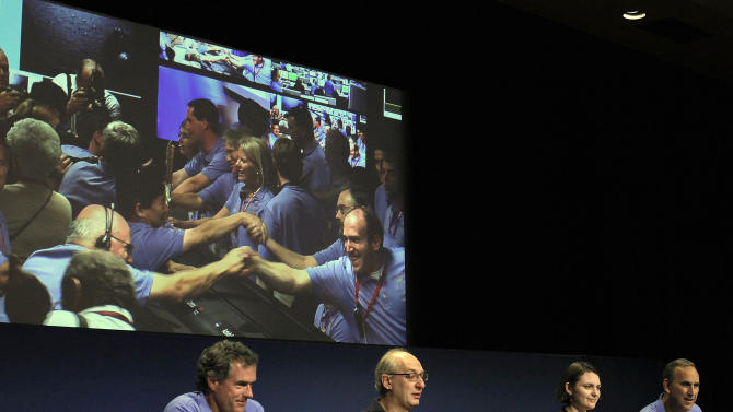 Jet Propulsion Laboratory scientists, from left to right, Michael Watkins, Miguel San Martin, Sarah Milkovich, and John Grotzinger, speak at a news conference following Sunday night's landing of Mars rover Curiosity, in Pasadena, Calif., on Monday, Aug. 6, 2012. (AP Photo/Nick Ut)