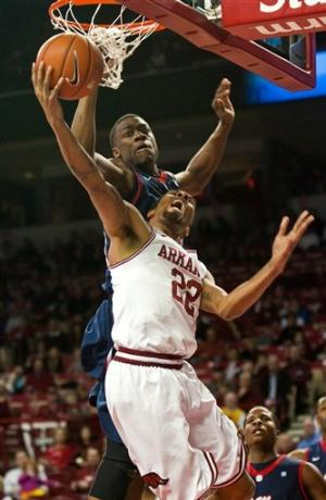 Henry's 19 lift Ole Miss past Arkansas 77-75