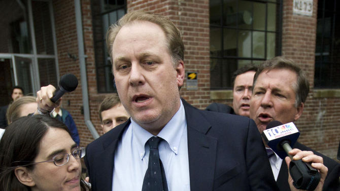 CORRECTS DATE IN SECOND SENTENCE TO NOV. 1, NOT NOV. 12 - FILE - In this May 16, 2012, file photo, former Boston Red Sox pitcher Curt Schilling, center, is followed by members of the media as he departs the Rhode Island Economic Development Corporation headquarters in Providence, R.I. The state of Rhode Island's economic development agency has filed a lawsuit against Schilling on Thursday, Nov. 1, 2012, and some of its own former officials in connection with a $75 million loan guarantee to his failed video game company. (AP Photo/Steven Senne, File)