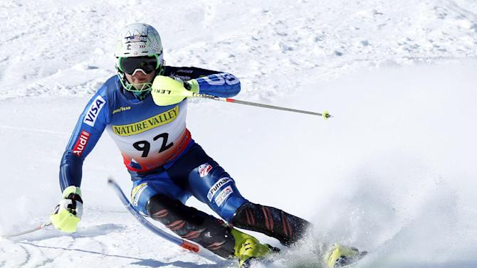 A.J. Ginnis, of Greece, knocks down a gate on his way to a second-place finish at the men's slalom ski race at the U.S. Alpine Championships, Sunday, March 29, 2015, at Sugarloaf Mountain Resort in Carrabassett Valley, Maine. (AP Photo/Robert F. Bukaty)