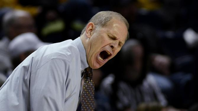 Michigan coach John Beilein reacts to a play during the second half of an NCAA college basketball game against Penn State in State College, Pa., Wednesday, Feb. 27, 2013. Penn State won 84-78. (AP Photo/Ralph Wilson)