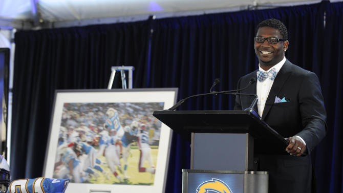 Former San Diego Chargers running back LaDainian Tomlinson speaks during a news conference at the teams' facility, Monday, June 18, 2012, in San Diego. He signed a one-day contract with the Chargers and announced his retirement after an 11-year NFL career. (AP Photo/Denis Poroy)