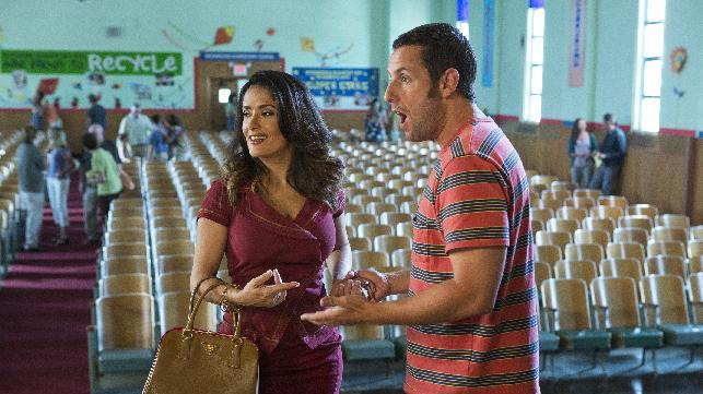 "This film publicity image released by Columbia Pictures shows Salma Hayek, left, and Adam Sandler in a scene from ""Grown Ups 2."" (AP Photo/Sony - Columbia Pictures, Tracy Bennett)"
