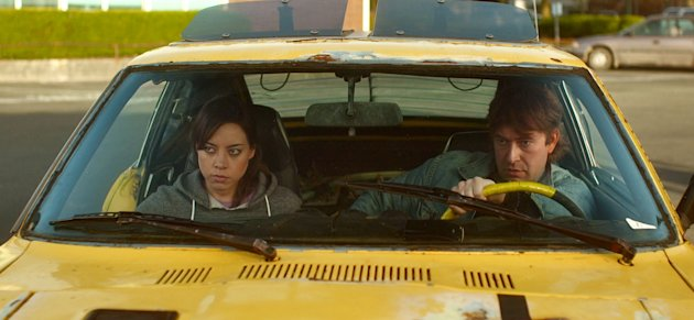 "This undated film image released by FilmDistrict shows Aubrey Plaza, left, and Mark Duplass in a scene from ""Safety Not Guaranteed."" (AP Photo/FilmDistrict)"