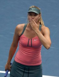 Maria Sharapova of Russia beats Sorana Cirstea of Romania at the China Open in Beijing. Meanwhile Novak Djokovic was reached the quarter-finals in straight sets with a win over unseeded Argentine Carlos Berlocq