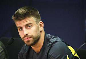 Barcelona's Gerard Pique attends a news conference after a training session at Ciutat Esportiva Joan Gamper in Sant Joan Despi near Barcelona