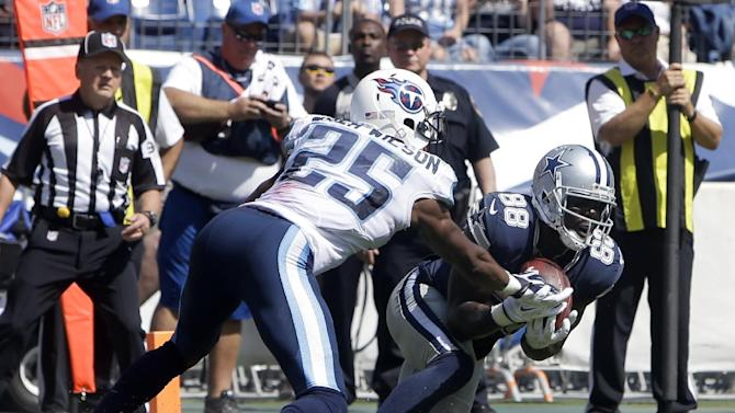 Dallas Cowboys wide receiver Dez Bryant (88) catches a touchdown pass as he is defended by Tennessee Titans cornerback Blidi Wreh-Wilson (25) on a 3-yard pass play in the third quarter of an NFL football game Sunday, Sept. 14, 2014, in Nashville, Tenn