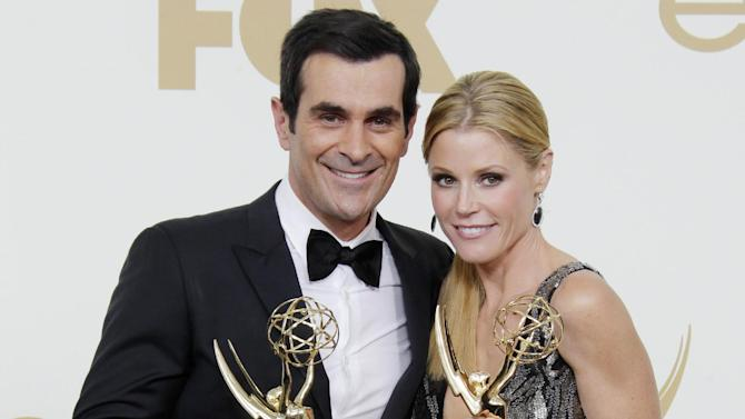 """FILE - This Sept. 18, 2011 file photo shows Ty Burrell, left, Julie Bowen from the television series  """"Modern Family"""" holding their Emmys for best supporting and actress actress in a comedy, backstage at the 63rd Primetime Emmy Awards in Los Angeles. Five stars of the hit ABC series sued 20th Century Fox Television on Tuesday July 24, 2012, claiming their contracts with the studio are illegal under California law and should be invalidated. (AP Photo/Jae Hong, file)"""