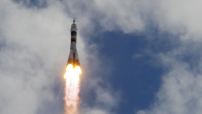 The Soyuz-FG rocket booster with Soyuz TMA-05M space ship carrying a new crew to the International Space Station, ISS, flies in the sky at the Russian leased Baikonur cosmodrome, Kazakhstan, Sunday, July 15, 2012. The Russian rocket carries Russian cosmonaut Yuri Malenchenko,  U.S. astronaut Sunita Williams and Japanese astronaut Akihiko Hoshide. (AP Photo/Dmitry Lovetsky)