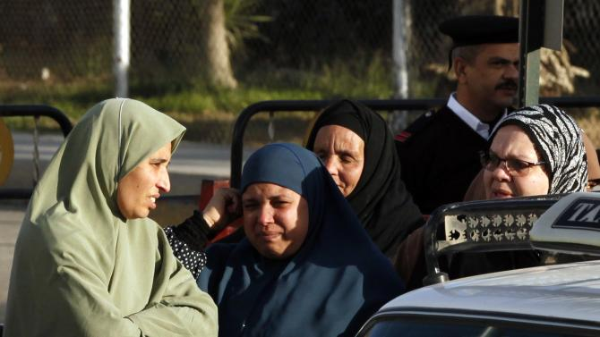 Relatives of security personnel killed in a series of attacks in Sinai Province, mourn in front of Almaza military airbase where the funerals were held, in Cairo