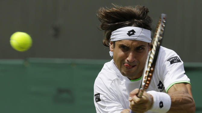David Ferrer of Spain returns to Ivan Dodig of Croatia in their Men's singles match at the All England Lawn Tennis Championships in Wimbledon, London, Monday, July 1, 2013. (AP Photo/Anja Niedringhaus)