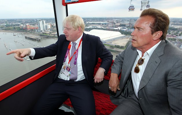 Arnold Schwarzenegger take a ride over the Thames with London mayor Boris Johnson