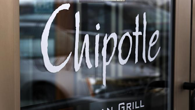 FILE - This Tuesday, Jan. 28, 2014, file photo, shows the door at a Chipotle Mexican Grill in Robinson Township, Pa. On Tuesday, April 29, 2014, Chioptle Chief Financial Officer Jack Hartung noted that the chain doesn't currently charge a whole lot more for its steak filling, even though beef costs have climbed considerably. He says Chipotle will widen the price gap between steak and chicken. (AP Photo/Gene J. Puskar, File)