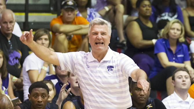 Kansas State head coach Bruce Weber yells to his team against Arizona in the first half of an NCAA college basketball game at the Maui Invitational on Tuesday, Nov. 25, 2014, in Lahaina, Hawaii. (AP Photo/Eugene Tanner)