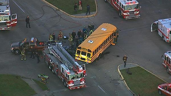 Car smashes into school bus
