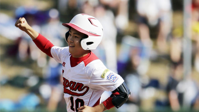 Tokyo, Japan's Noriatsu Osaka celebrates as he rounds the bases after hitting a two-run home run in the fifth inning of the Little League World Series championship baseball game against Goodlettsville, Tenn., Sunday, Aug. 26, 2012, in South Williamsport, Pa. Japan won 12-2 in five innings. (AP Photo/Matt Slocum)