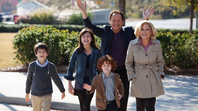 """FILE - This undated publicity file photo released by Twentieth Century Fox and Walden Media shows Billy Crystal as Artie and Bette Midler as Diane, who agree to babysit their three grandkids, from left, Joshua Rush as Turner, Bailee Madison as Harper and Kyle Harrison Breitkopf as Barker in a scene from the film, """"Parental Guidance.""""  (AP Photo/Twentieth Century Fox/Walden Media, Kerry Hayes, File)"""
