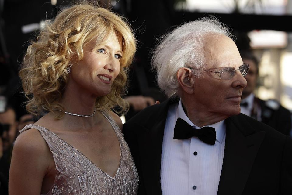 Actress Laura Dern, left, and her father actor Bruce Dern pose for photographers as they arrive for the screening of Nebraska at the 66th international film festival, in Cannes, southern France, Thursday, May 23, 2013. (AP Photo/David Azia)