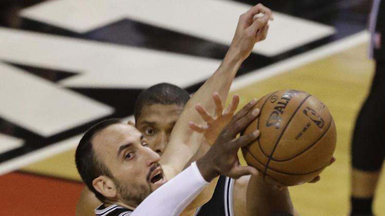 Miami Heat's Dwyane Wade (3) shoots against San Antonio Spurs' Manu Ginobili (20) of Argentina during the first half in Game 7 of the NBA basketball championships, Thursday, June 20, 2013, in Miami. (AP Photo/Wilfredo Lee)