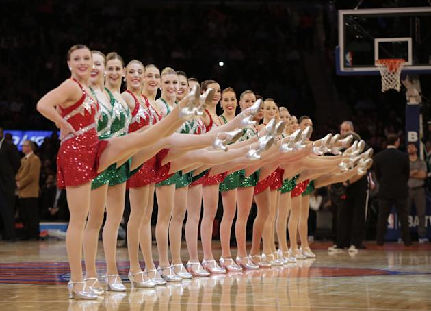 The Rockettes perform during a timeout in the first half of the New York Knicks NBA basketball game Chicago Bulls at Madison Square Garden in New York, Wednesday, Dec. 11, 2013