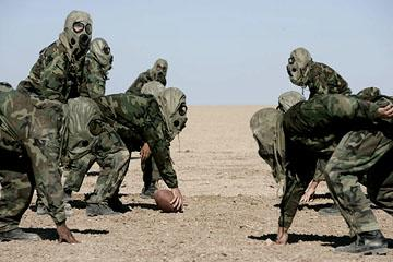 Marines playing desert football in Universal Pictures' Jarhead